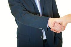 Zwei Geschäftsleute Rütteln überreichen ein neues Geschäft stockbild