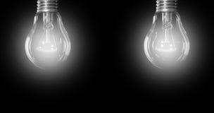Zwei glänzende elektrische Lampen Stockfotos