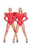 Zwei go-go Tänzer im roten Stufekostüm Stockbilder