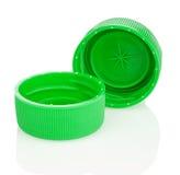 Zwei grüne Plastikkappen lizenzfreies stockbild