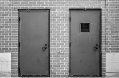 Zwei Gray Doors Stockfotos
