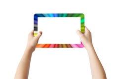 Zwei Hände, die bunte Tablette anhalten Stockbild