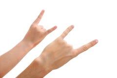 Zwei Hände, die eine Felsengeste bilden Stockfotografie