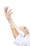 Zwei Hände, die Gummihandschuhe streching sind Lizenzfreie Stockfotografie