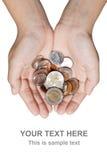 Zwei Hände, die Münzen anhalten Lizenzfreie Stockbilder