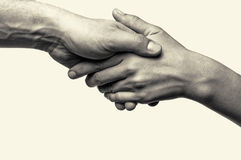 Zwei Hände - Hilfe Stockfotos