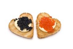 Zwei Hören-förmige Toast mit Kaviar Lizenzfreies Stockfoto