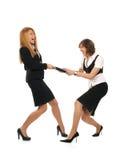 Zwei jung und reizvolle Geschäftsfrauen in einem Kampf Lizenzfreie Stockfotografie