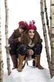 Zwei junge Frauen auf einem Schlitten Stockfotografie
