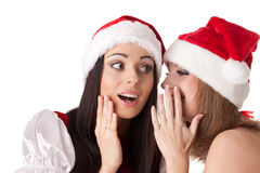 Zwei junge Frauen im Sankt-Kostüm. Stockbild