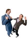 Zwei junge Geschäftsmänner, die etwas behandeln Lizenzfreie Stockfotografie