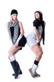 Zwei junge hübsche Frauen werfen auf Stockbild