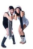 Zwei junge hübsche Frauen werfen auf Stockfotografie