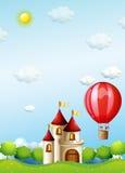 Zwei Jungen, die in eine Heißluft reiten, steigen nahe dem Schloss im Ballon auf Stockbild