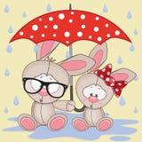 Zwei Kaninchen mit Regenschirm Lizenzfreies Stockfoto