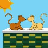 Zwei Katzen auf Backsteinmauer Stockfotos