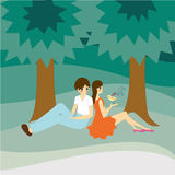 Zwei Kinder unter dem Baum Stockfotografie