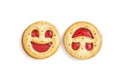Zwei lächelnde Gesichter der runden Kekse, humorvolles süßes Lebensmittel, lokalisiert stockfotografie