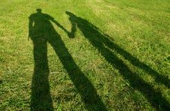 Zwei Leuteschattenbilder Stockfoto