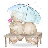 Zwei Liebhaberbären, die auf einer Bank unter einem Regenschirm sitzen Lizenzfreie Stockbilder