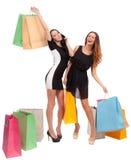 Zwei Mädchen mit Einkaufstaschen Stockbilder