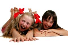 Zwei Mädchen mit schmutzigen Sohlen Lizenzfreies Stockfoto