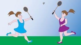 Zwei Mädchen spielen ein Sportspielbadminton Lizenzfreies Stockbild