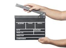 Zwei männliche Hände, die Filmproduktions-Scharnierventilbrett lokalisiert halten stockfoto