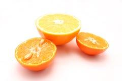 Zwei Mandarinen und Orange Lizenzfreie Stockfotos