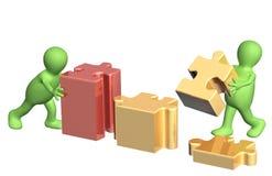 Zwei Marionetten mit Puzzlespielen Lizenzfreie Stockbilder