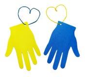 Zwei mehrfarbige Hände Lizenzfreie Stockfotos