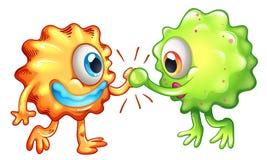 Zwei Monster, die Teamwork zeigen Stockbilder