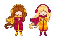 Zwei nette kleine Mädchen, tragende Mäntel und große gestrickte Schals Autumn Fashion lizenzfreie abbildung