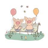 Zwei nette kleine Schweine, die auf einer Bank mit Ballonen sitzen Stockfotos