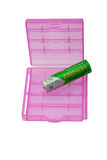 Zwei Plastikbatteriehalterung und eine Batterie auf Weiß Stockfotografie