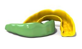 Gummi-Schutz-Grün und Goldfront Stockfotos