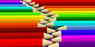 Zwei Reihen von den farbigen Bleistiften, die herum mit Fokuseffekt liegen Stockfotografie