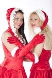 Zwei reizvolle Sankt-Mädchen, die Spaß haben Stockfotografie