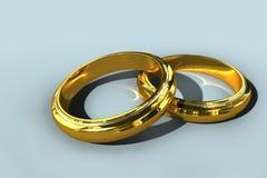 Zwei Ringe der goldenen Hochzeit Stockfotos