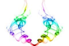 Zwei Rotationen des Rauches mit hellen Regenbogenfarben Stockfotografie