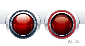 Zwei rote glatte Knöpfe Stockfotos