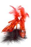 Zwei rote Kristallhefterzufuhren mit Federn Stockfoto