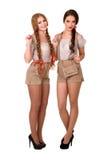 Zwei schöne blonde und Brunettemädchen von oktoberfest Stockbild
