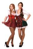 Zwei schöne blonde und Brunettemädchen von oktoberfest Stockfoto