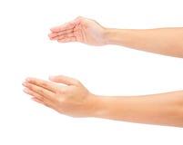 Zwei schöne Frauenhände getrennt auf Weiß Stockfotografie