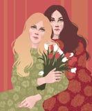 zwei schöne Freundinnen und ein Blumenstrauß von Tulpen stock abbildung