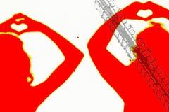 Zwei Schattenbilder von Leuten im Rot, das eine Liebe macht, unterzeichnen Stockfotos