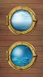 Zwei Schiffsfenster mit dem Ozean Oberflächen und unter Wasser tief stockfoto