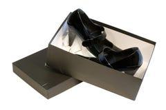 Zwei Schuhe im Kasten Stockfoto