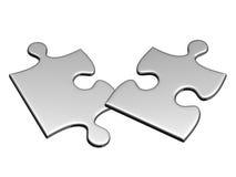 Zwei silberne Puzzlespiele, die fliegen, um zu lüften Stockbild